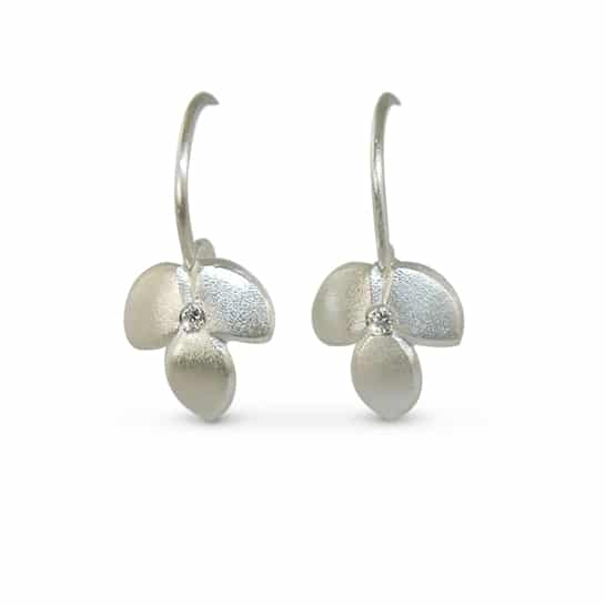 Silver diamond drop earrings come in a contemporary satin finish by Jacks Turner