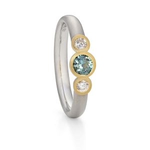 Teal sapphire and diamond trilogy ring designed by Jacks Turner Bristol