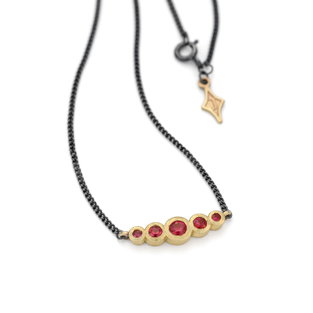 Ruby graduated bar necklace 9ct gold with tag. Jacks Turner Jewellery Bristol