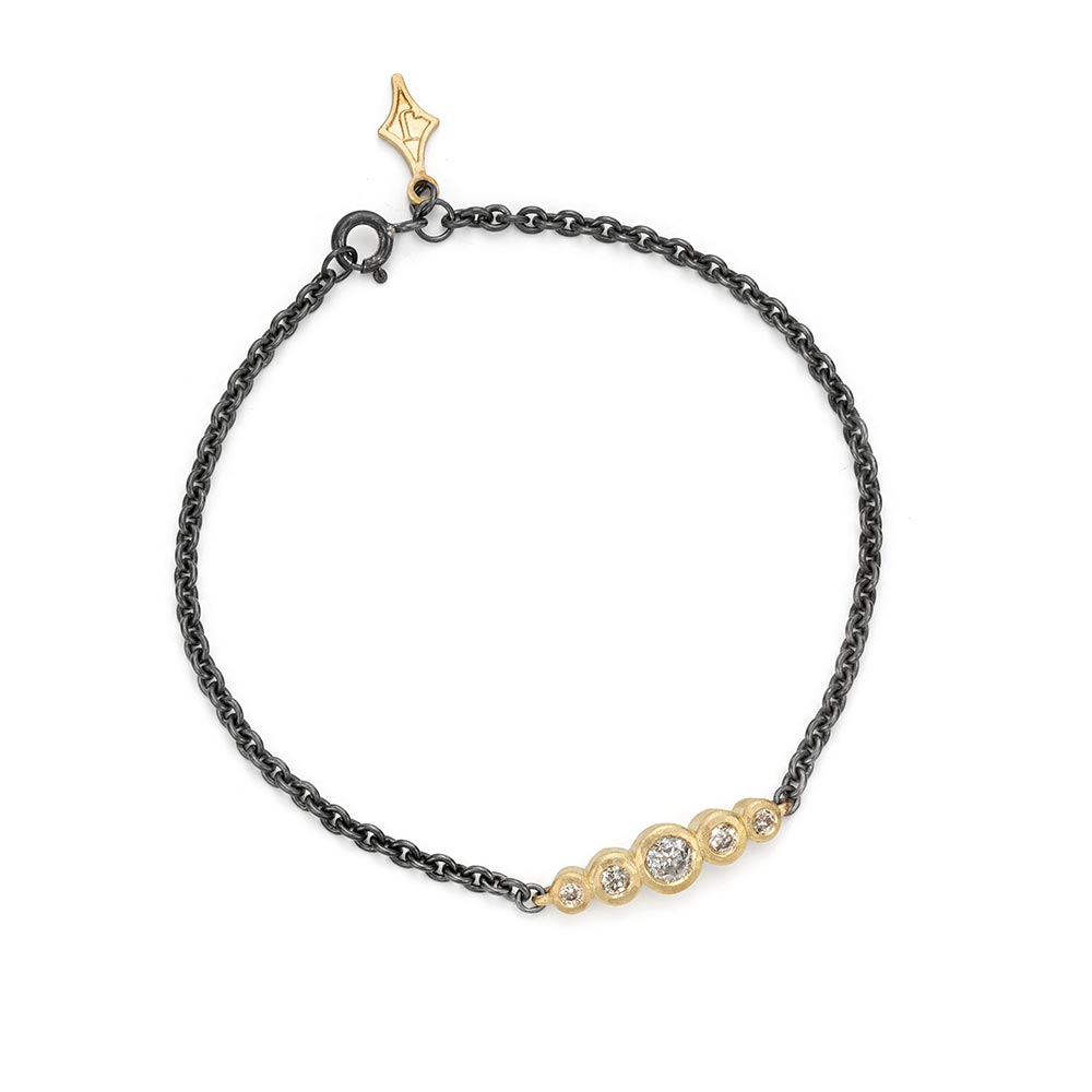 Salt and pepper graduated bar bracelet in 9ct gold. Jacks Turner Jewellery Bristol