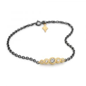 Salt and pepper graduated bar bracelet in 9ct gold with tag. Jacks Turner Jewellery Bristol