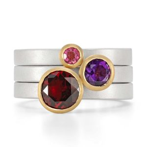 Sunset trumpet stacking rings in silver with 18ct gold settings. Handmade by Jacks Turner in her Bristol studio.